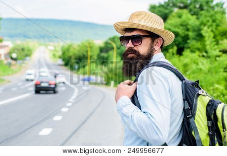 Adventure Spirit. Hitchhiker Try To Stop Transport To Get To Destination. Man At Edge Of Highway Loo