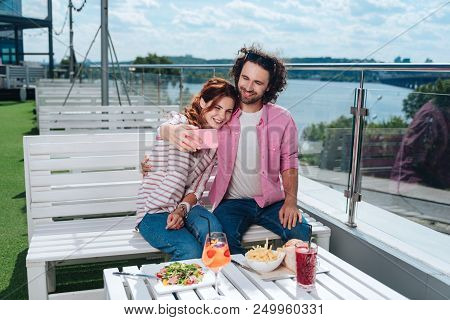 Beaming Woman. Beaming Woman Making Selfie With Her Boyfriend While Eating Healthy Food And Drinking