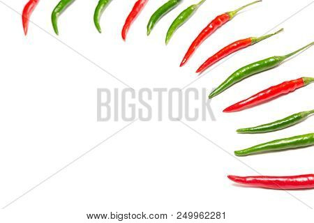 Red And Green Chili Peppers On White Background. Selective Focus, Copy Space