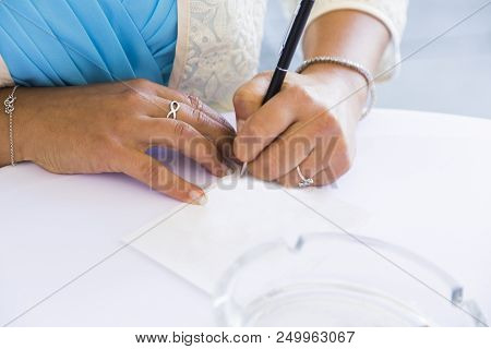 Wedding Ceremony. Bride Or Witness In Blue Dress Leaving Her Signature In Marriage Certificate