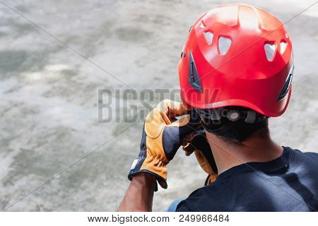 Work Safety Background Concept.soft Focus Close Up Young Man Asian Wear The Red Helmet With Leather