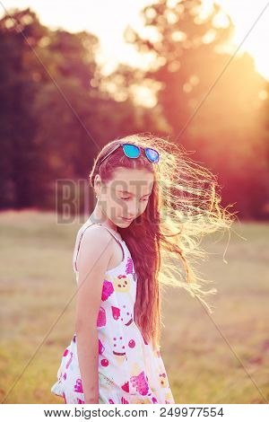 Beautiful Teen Girl Is Dancing In The Park At Summer Sunset