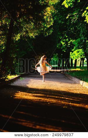 Beautiful Teenager Girl  Is Dancing Outside At  Summer Sunset