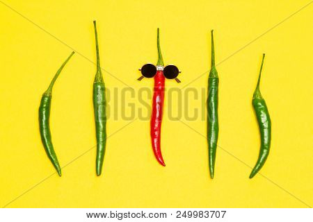 Red Chili Pepper In Sunglasses Surrounded By Green Peppers. The Coolest Guy, Party Goer Bright Funny