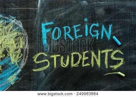 Foreign Students Exchange Program Concept With Handwritten Text In Chalk On School Blackboard