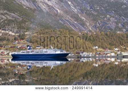 Cruised Ship Has Moored In The Hardangerfjord Near The Norwegian Village Eidfjord