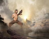 Man practices martial arts with bird of prey at dawn poster