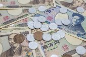 Closeup of Japanese yen banknotes and Japanese yen coin concept background poster
