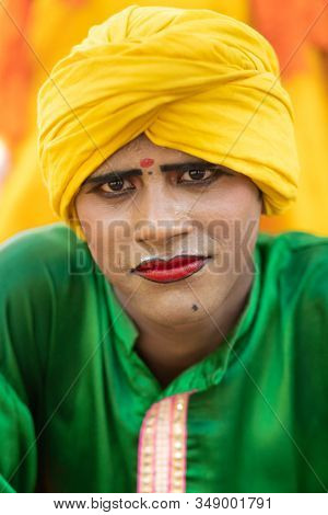 SARNATH, INDIA, JANUARY 22, 2019 : Portrait of an Indian artist traditional dancer in the streets of the Sarnath city.