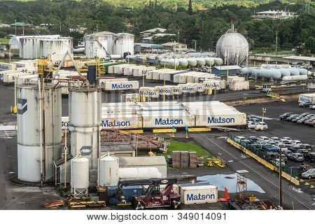 Hilo, Hawaii, Usa. - January 14, 2020: Ocean Port. White Gas And Fuel Tanks Surrounded By Matson Shi
