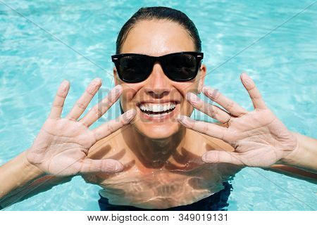 Happy Smiling Woman Showing Fingers Got Wrinkly From Stayed In A Pool So Long