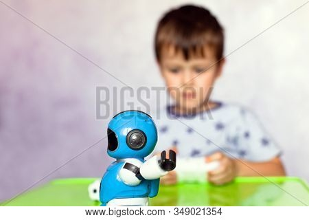 Little Boy Is Playing With Robot. Robot For Children. Smart Toy. Selective Focus On Toy Robot