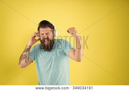 Song Has Healing Power. Emotional Song Singer. Hipster Sing Song Playing In Headphones. Bearded Man