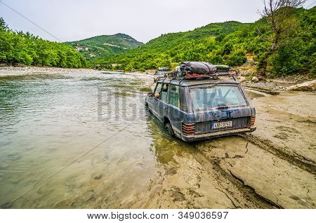 Lapanj, Albania - August 01, 2014. Off Road Car Stucked In The Mud By River Osumi