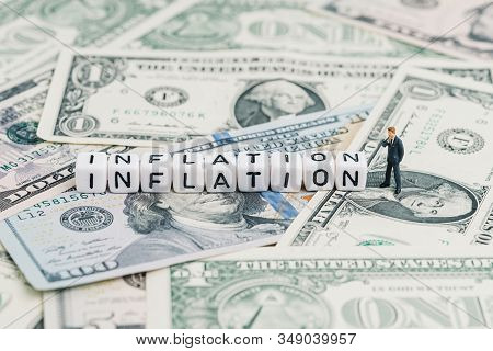 Miniature People Businessman Standing And Wise Thinking With Cube Block Combine Word Inflation On Us