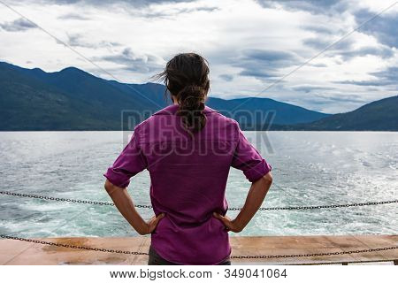 Close Up From Behind Of A Man On The Deck Of A Passenger Ferryboat. Meditative Position With Arms On