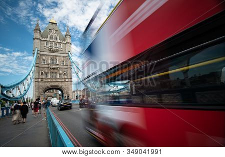 London United Kingdom, July 5 2019 :  People Walking And Red Traditional London Bus Crossing The Fam