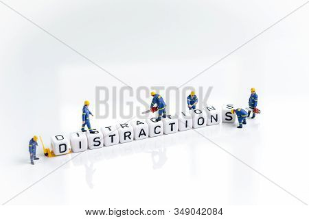 Eliminate Distractions That Draw Attention To Losing Focus Concept, Miniature People Man Working On