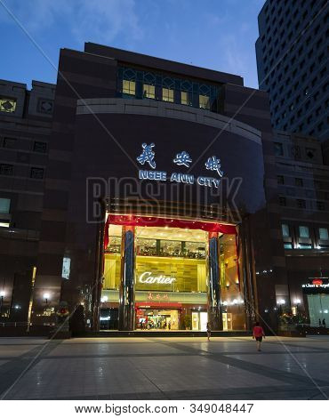 Singapore, January 2020.  The Chanel Store In Ngee Ann City Shopping Mall At Sunset