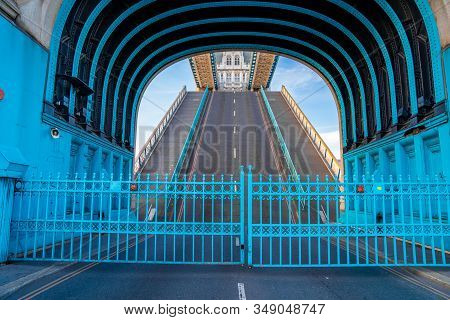 London Tower Bridge Lifted Up And The Road Is Closed With Blue Gates. View From The Middle Of The Ca