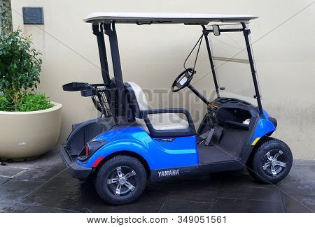 New Orleans, Louisiana, U.s.a - February 4, 2020 - A Blue Color Of An Electric Golf Cart By Yamaha