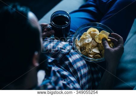 Emotional Eating, Alcohol Addiction, Depression, Loneliness, Stress. Lonely Man Watching Tv Eating J