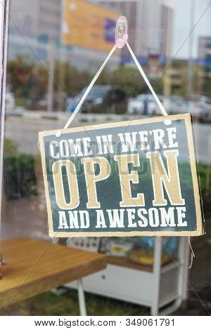 Open Sign Hanging On Cafe Glass Window