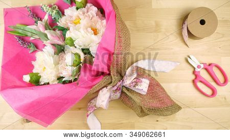Flowers Wrapped In Pink Tissue And Hessian Modern Trend Wrapping Flatlay.
