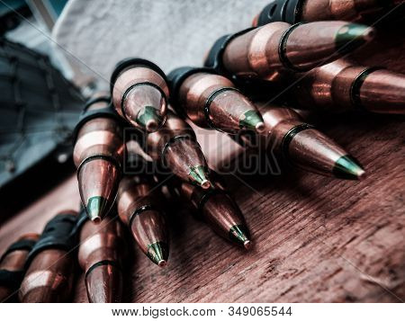 A Macro Close Up View Of A Row Of Regular Army Brass And Copper Bullets.