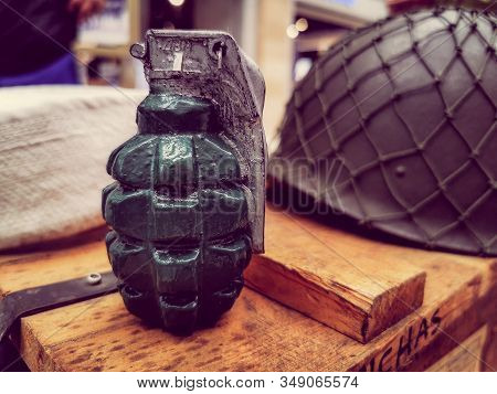 Close Up View Of Hand Grenade On Boxes Of Army Supplies.
