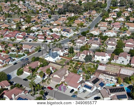 Aerial View Of Typical Suburban Neighborhood With Big Villas Next To Each Other During Sunny Day, Sa