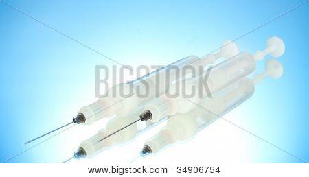 syringes monovet on blue background