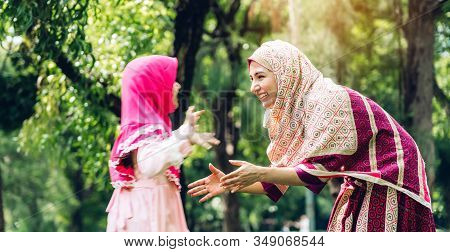 Portrait Of Happy Happy Lovely Family Arabic Muslim Mother And Little Muslim Girls Child With Hijab