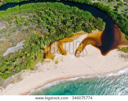 Aerial Top View Of River Merging To Tropical White Sand Beach And Turquoise Clear Sea Water With Sma