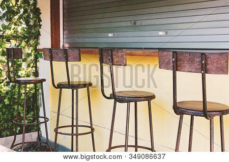 Empty Bar - Bar Stools At The Closed Bar Counter. Small Business Fail Concept