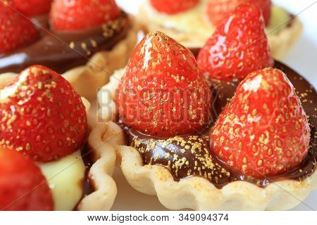 Closeup Mouthwatering Fresh Strawberry Tarts With Edible Gold Powder