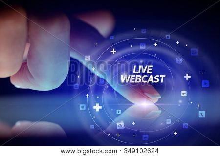 Finger touching tablet with social media icons and LIVE WEBCAST