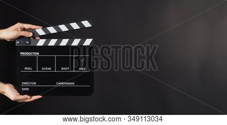 Hand Is Holding Black Clap Board Or Movie Slate  Use In Video Production , Movie ,film, Cinema Indus