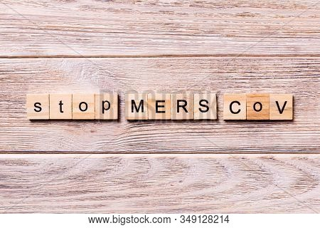 Stop Mers Cov Word Written On Wood Block. Stop Mers Cov Text On Wooden Table For Your Desing, Corona