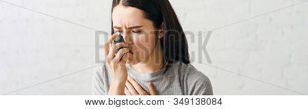 Panoramic Shot Of Sick Woman Using Asthmatic Inhaler At Home