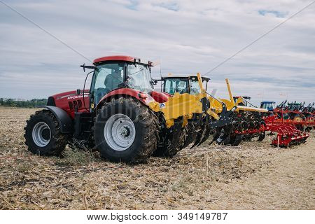 New Agricultural Machinery, Tractors In Motion At Demonstration Field Site At Agro Exhibition Agroex