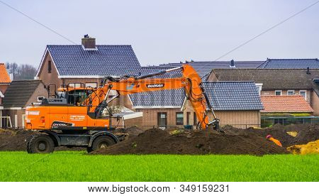 Doosan Excavator Digging And Moving Sand, Construction Groundwork In Rucphen, The Netherlands, 31 Ja
