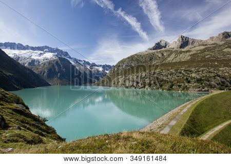 Lake In The Swiss Mountains On A Sunny Summer Day