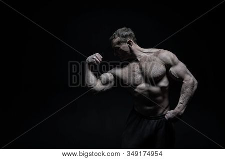 Perfect Body. Man Bodybuilder Posing With Tense Muscles On Black Background. Bodybuilder Achieved Be