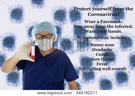 2019 Novel Coronavirus. 2019-nCoV.  Wuhan, China Coronavirus. Doctor or Medical Scientist examines a vile of blood infected with the Wuhan, China Coronavirus. Doctor in Protective Scrubs with virus.