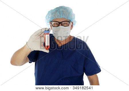 2019 Novel Coronavirus. 2019-nCoV.  Wuhan, China Coronavirus. Doctor or Medical Scientist examines a vile of blood infected with the Wuhan, China Coronavirus. Doctor in Protective Scrubs with virus.