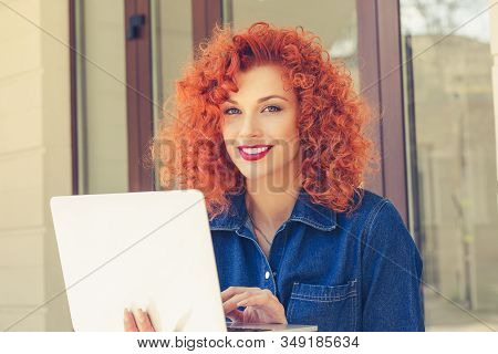 Happy Daydreaming Young Woman Holding Open Notebook, Looking Camera, Smiling, Sitting Outdoor. Portr
