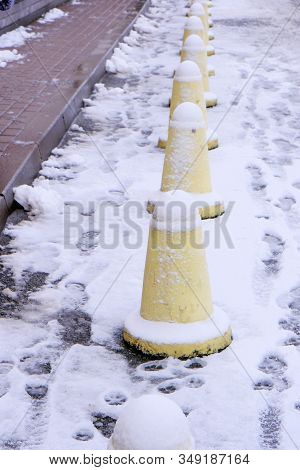 Small Concrete Posts, Carriageway Limiters, Pedestrian Walkway Protection, Close-up Shot In Winter