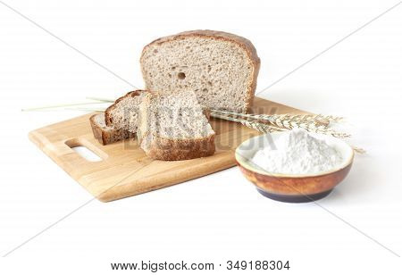 Rye And Wheat Bread. A Piece Of Bread. A Loaf Of Bread On A Cutting Board With Ears Of Wheat And A H