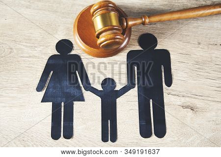 Judge With Paper Of  Family On The Desk